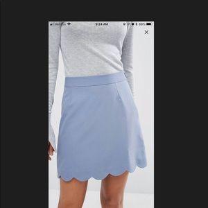 Pale blue mini skirt